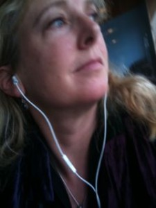 I took this photo by mistake, but I quite like it. Me and earbuds. In a coffee shop, not on a boat.
