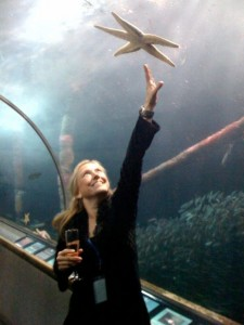Reaching for the stars (haha) at the Aquarium of the Bay in San Francisco